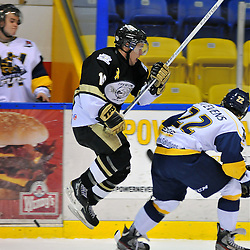WHITBY, ON - Dec 9: Ontario Junior Hockey League game between Trenton Golden Hawks and Whitby Fury. Michael Walker #16 of the Trenton Golden Hawks avoids the attempted check from Kevin Stevens #22 of the Whitby Fury during first period game action..(Photo by Shawn Muir / OJHL Images)
