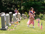 Hamptonburgh, N.Y. - Young girls place flowers on a veterans' graves during a Memorial Day service at Hamptonburgh Cemetery on May 29, 2006. ©Tom Bushey