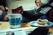 Man and woman have a cuppa in student accommodation, Leeds, U.K,  2000.