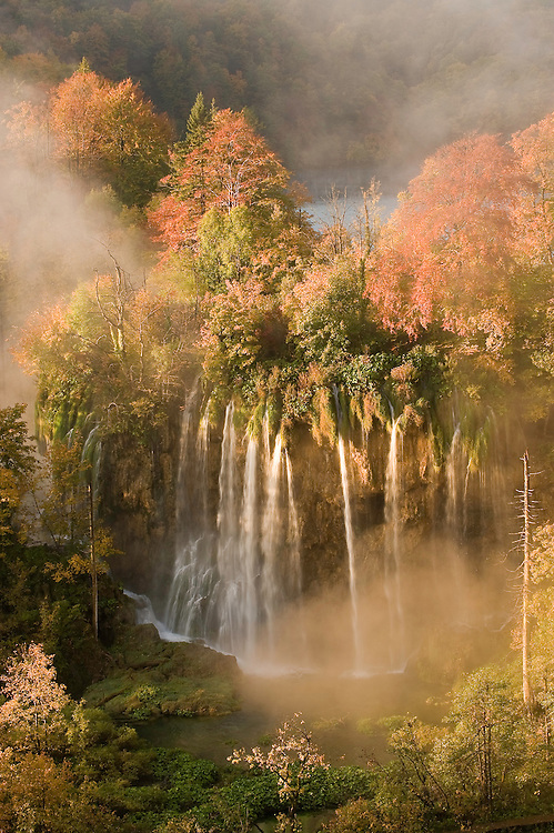 Daybreak light and fog on the Veliki Prstvaci waterfalls close to Gradinsko lake, Upper Lakes, Plitvice National Park, Croatia