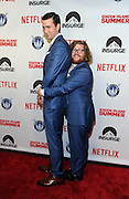 Actor Zack Pearlman, right, and Nicholas Braun strike a prom pose at the premiere of the movie Staten Island Summer at Sunshine Cinema, Tuesday, July 21, 2015, in New York.  The new comedy debuts on Netflix on July 30, 2015 and is available for Digital download. (Photo by Diane Bondareff/Invision for Paramount Pictures/AP Images)
