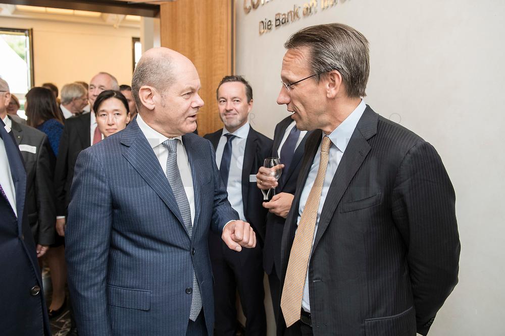 """18 JUN 2018, BERLIN/GERMANY:<br /> Olaf Scholz (L), SPD, Bundesfinanzminister, und Dr. Joerg Kukies (R), Staatssekretaer im Bundesministerium der Finanzen, im Gespraech, Veranstaltung Wirtschaftsforum der SPD: """"Finanzplatz Deutschland 2030 - Vision, Strategie, Massnahmen!"""", Haus der Commerzbank<br /> IMAGE: 20180618-01-038<br /> KEYWORDS: Jörg Kukies, Gespräch"""
