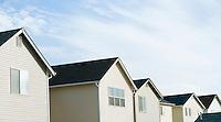 Row of suburban houses and sky&#xA;<br />
