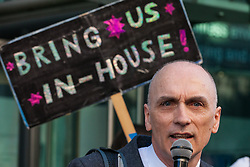 London, UK. 26th February, 2019. Chris Williamson, Labour MP for Derby North, addresses mainly migrant striking outsourced workers belonging to the Independent Workers of Great Britain (IWGB), United Voices of the World (UVW) and Public and Commercial Services Union (PCS) trade unions working at the University of London (IWGB), Ministry of Justice (UVW) and Department for Business Energy and Industrial Strategy (PCS), together with representatives of the National Union of Rail, Maritime and Transport Workers (RMT) Regional Council, taking part in a 'Clean Up Outsourcing' demonstration to call for an end to the practice of outsourcing. The demonstration was organised to coincide with a significant High Court hearing of an application by the IWGB for judicial review of a decision by the Central Arbitration Committee (CAC) not to hear their application for trade union recognition for the purposes of collective bargaining with the University of London.