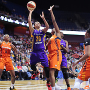 UNCASVILLE, CONNECTICUT- JULY 15:  Kristi Toliver #20 of the Los Angeles Sparks drives to the basket defended by Morgan Tuck #33 of the Connecticut Sun during the Los Angeles Sparks Vs Connecticut Sun, WNBA regular season game at Mohegan Sun Arena on July 15, 2016 in Uncasville, Connecticut. (Photo by Tim Clayton/Corbis via Getty Images)