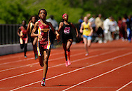 9 APRIL 2011 -- UNIVERSITY CITY, Mo. -- Hazelwood East HIgh School runner Shayla Luckett leads the pack to the finish line during the girls' 400 meter run at the Charlie Beck Invitational track meet at University City High School in University City, Mo. Saturday, April 9, 2011. Lucket won the event and set a new meet record. Image (c) copyright 2011 Sid Hastings.