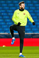 Gerard Pique of FC Barcelona trains ahead of the UEFA Champions League tie against Manchester City - Photo mandatory by-line: Matt McNulty/JMP - Mobile: 07966 386802 - 23/02/2015 - SPORT - Football - Manchester - Etihad Stadium