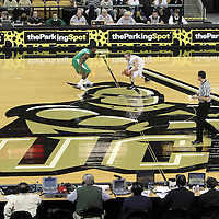 Central Florida guard A.J. Rompza (3) dribbles the ball up-court during a Conference USA NCAA basketball game between the Marshall Thundering Herd and the Central Florida Knights at the UCF Arena on January 5, 2011 in Orlando, Florida. Central Florida won the game 65-58 and extended their record to 14-0.  (AP Photo/Alex Menendez)