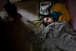 Reshma Khavle,16, has had TB for 4 months but is not getting any better.  She sleeps on the floor in a small apartment that she shares with her grandmother and other family members.  She rarely gets up and spends most of her time on the floor of the apartment.