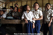 Students are gathered to listen to a teacher's announcement at The Ban Buamlao Primary School in Ban Buamlao, Laos.