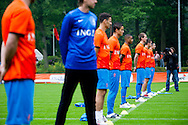 NETHERLANDS, HOENDERLOO : A cameraman is taking a head shot of the Dutch Players before the training at the trainingcamp of the Netherlands national football team in Hoenderloo on May 31, 2012. AFP PHOTO/ ROBIN UTRECHT