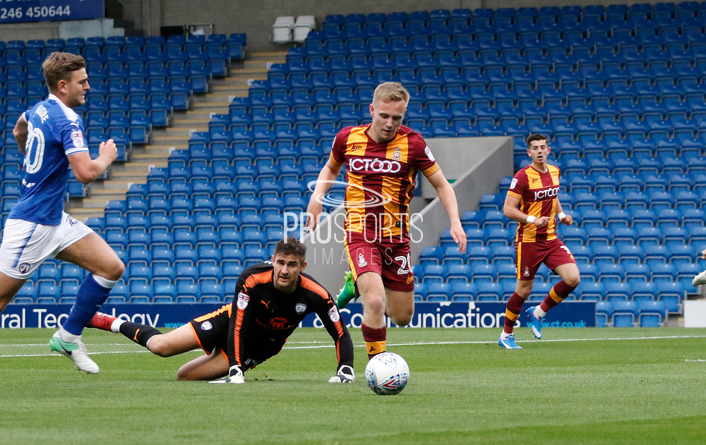 Dan Pybus of Bradford City goes past Joe Anyon of Chesterfield only for a Chesterfield defender to clear off the line during the EFL Trophy match between Chesterfield and Bradford City at the b2net stadium, Chesterfield, England on 29 August 2017. Photo by Paul Thompson.