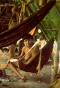 South American Indians: Venezuela, Guyana Highlands, Eñepa (Panare) woman spinnng cotton in temporary camp.