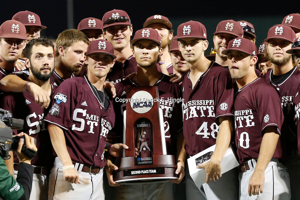 Jun 25, 2013; Omaha, NE, USA; Mississippi State Bulldogs players pose with the second place trophy after game 2 of the College World Series finals against the UCLA Bruins at TD Ameritrade Park. UCLA defeated Mississippi State 8-0. Mandatory Credit: Derick E. Hingle-USA TODAY Sports