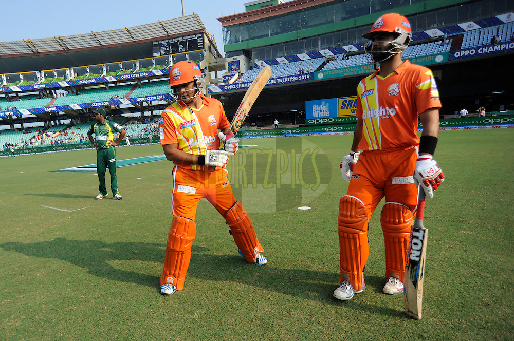 Umar Siddique of Lahore Lions and Ahmed Shehzad of Lahore Lions walk to bat during the qualifier 5 match of the Oppo Champions League Twenty20 between the Southern Express and the Lahore Lions held at the Chhattisgarh International Cricket Stadium, Raipur, India on the 16th September 2014<br /> <br /> Photo by:  Pal Pillai / Sportzpics/ CLT20<br /> <br /> <br /> Image use is subject to the terms and conditions as laid out by the BCCI/ CLT20.  The terms and conditions can be downloaded here:<br /> <br /> http://sportzpics.photoshelter.com/gallery/CLT20-Image-Terms-and-Conditions-2014/G0000IfNJn535VPU/C0000QhhKadWcjYs