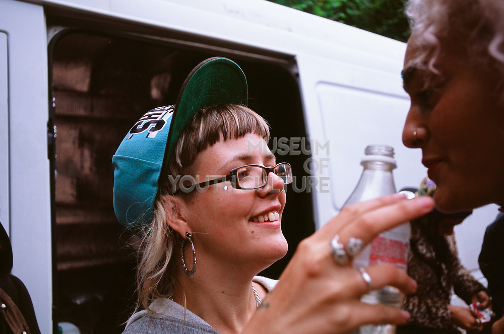 Ravers sharing a drink, Wales 2012