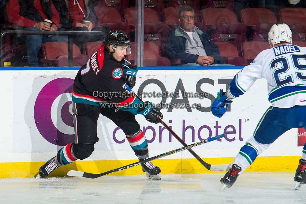 KELOWNA, CANADA - OCTOBER 23:  Libor Zabransky #7 of the Kelowna Rockets shoots the puck past Tanner Nagel #25 of the Swift Current Broncos during second period on October 23, 2018 at Prospera Place in Kelowna, British Columbia, Canada.  (Photo by Marissa Baecker/Shoot the Breeze)