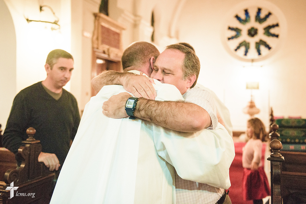 The Rev. Adam Lehman, LCMS career missionary to Spain, receives a hug during worship on Saturday, Nov. 5, 2016, in Madrid, Spain.  LCMS Communications/Erik M. Lunsford