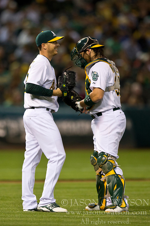 OAKLAND, CA - JULY 05:  Scott Kazmir #26 of the Oakland Athletics talks to Derek Norris #36 during the sixth inning against the Toronto Blue Jays at O.co Coliseum on July 5, 2014 in Oakland, California. The Oakland Athletics defeated the Toronto Blue Jays 5-1.  (Photo by Jason O. Watson/Getty Images) *** Local Caption *** Scott Kazmir; Derek Norris