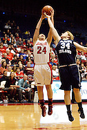 UD freshman Andrea Hoover (24) and Rhode Island freshman Marie Byrnes (34) as the Rhode Island Rams play the University of Dayton Flyers at UD Arena in Dayton, Saturday, January 7, 2012.