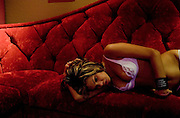 """Sex worker Skye High takes a break in the parlor of the Moonlite Bunny Ranch brothel in Mound House, NV on Thursday, July 27, 2006...The Moonlite Bunny Ranch brothel in Mound House, Nevada - just a few miles from the state capital in Carson City - first opened in 1955. The Ranch is a legal, licensed brothel owned by Dennis Hof. It's featured in the HBO series """"Cathouse."""""""