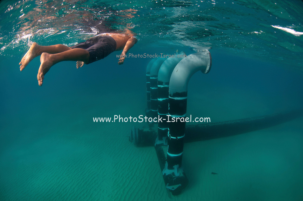 Brine discharge pipe and vent from a desalination plant on the seabed to a distance of 300 meter from the shore. Brine discharge can have a negative impact on the ocean ecosystem. Photographed in Israel Mediterranean sea