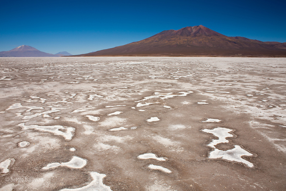 The Salar de Chiguana is a high-altitude muddy salt pan that straddles the boder of Bolivia and Chile and floods seasonally creating interesting patterns of salt deposits and is located in the Sud Lipez region of the Dept. of Potosi in southwestern Bolivia.