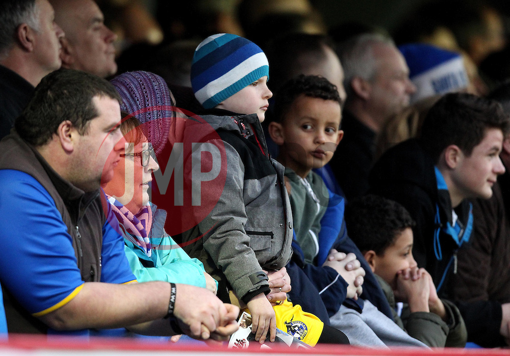 A young Bristol Rovers fan watches play - Mandatory byline: Robbie Stephenson/JMP - 07966 386802 - 26/12/2015 - FOOTBALL - Kingsmeadow Stadium - Wimbledon, England - AFC Wimbledon v Bristol Rovers - Sky Bet League Two