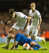 Tottenham Hotspur's Eric Lamela fights for the ball with Tromsø Idrettslag's Ruben Kristiansen reacts during their UEFA Europa League group match at White Hart Lane in London, 27 August 2013.  BOGDAN MARAN / BPA