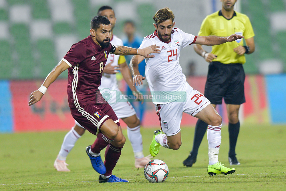 Ali Gholizadeh (R) of Iran vies for the ball with Tomas Rincon (L) of Venezuela during the international friendly soccer match between Iran and Venezuela at Al Ahli Stadium Doha, Capital of Qatar, November 20, 2018. The match ended with a 1-1 draw. (Credit Image: © Nikku/Xinhua via ZUMA Wire)