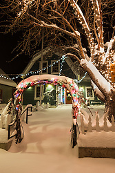 """Downtown Truckee 11"" - Photograph of a snow covered sidewalk and Christmas lights in front of a building in Downtown Truckee, California. Photographed in the early morning."