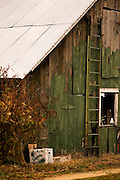 A left over packing box for peppers accents an old rustic barn located on an organic farm in Gloucester County, NJ.