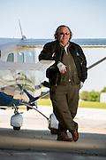 Angel Flight pilot John Ervin stands next to a plane in Springdale, Arkansas.