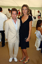 Actor TOM HOLLANDER and DIXIE CHASSAY at the Cartier International polo at Guards Polo Club, Windsor Great Park, on 30th July 2006.<br />