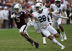 Texas A&M running back Trayveon Williams (5) breaks away from Auburn defensive back Tray Matthews (28) for a big gain after a catch during the second quarter of an NCAA college football game on Saturday, Nov. 4, 2017, in College Station, Texas. (AP Photo/Sam Craft)