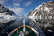 A very calm morning, cruising through the Lemaire channel, near the Antarctic peninsula on the Scandinavian-built ice-breaker Akademik Sergey Vavilov, which was originally built for the Russian Academy of Science and still used occasionally by scientists. It is now predominantly used for adventure touring in both the Arctic and the Antarctic. The ship is currently operated by a Russian crew, and staffed with employees of the adventure touring company Quark Expeditions, and carries around 100 passengers at a time. Antarctic Peninsula..