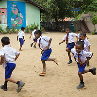 Pupils play games at the K.M. Vivekanana Vidalayam school in Kalmunai, Ampara Dist. <br /> <br /> The Kalmunai community was tsunami affected and for six months the school grounds became an IDP camp. The school continued teaching during this time in a local temple. The school is known as a &quot;Child Friendly School&quot;. Unicef has provided sanitary facilities: boys and girls toilets and hand washing area. Immediately after the tsunami, Unicef supplied books to the school. Unicef has trained teachers in child friendly education and in the establishment of a Children's Brigade. Children's Brigades are a means of promoting hygiene practice in pupils and encouraging them to disseminate messages of hygiene practice and awareness in the wider community.<br /> <br /> Photo: Tom Pietrasik<br /> Ampara District, Sri Lanka<br /> September 29th 2009
