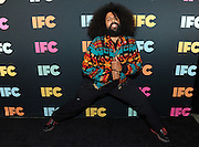 Reggie Watts, of Comedy Bang! Bang!, attends the IFC Upfront 2014 event, Thursday, March 20, 2014, at Roseland Ballroom in New York.  (Photo by Diane Bondareff/Invision for IFC/AP Images)