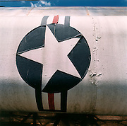 NASA Space Junk Auction.Atlas rocket.A 90ft US Air Force Atlas rocket lies on its transporter, its wafer-thin skin still intact after years of storage. Rocket scientist Charles Bell, paid $10 for it though it is estimated that it cost $10m to build. It had been standing at Patrick Air Force Base at Cape Canaveral until a storm blew a tree into it. It is estimated these rockets cost around $10m to build at the time though they were bought at auction for $10,000.