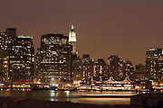 Looking across the East River at the South Street Seaport and Lower Manhattan from the Promenade at Brooklyn Heights on the evening of December 30, 2007