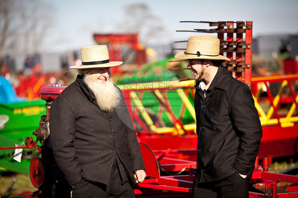 Amish men inspect farm equipment during the Annual Mud Sale to support the Fire Department  in Gordonville, PA.