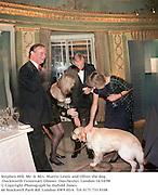 Stephen Hill, Mr. & Mrs. Martin Lewis and Oliver the dog. Duckworth Centenary Dinner. Dorchester, London 14/10/98<br />© Copyright Photograph by Dafydd Jones<br />66 Stockwell Park Rd. London SW9 0DA<br />Tel 0171 733 0108