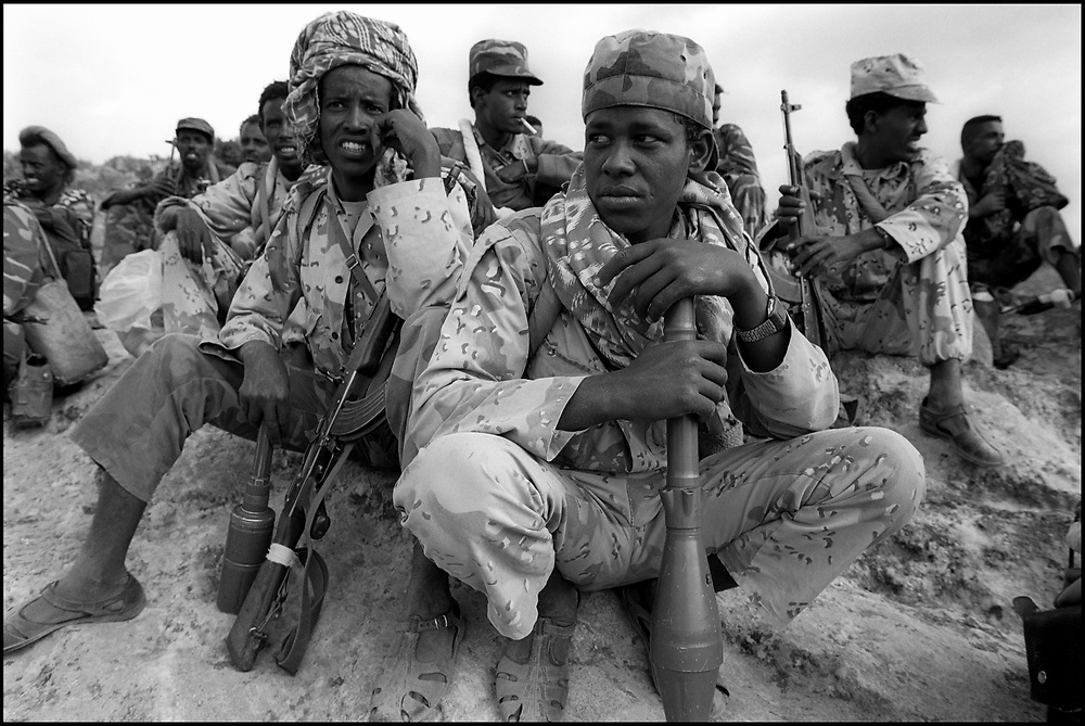 Eritrean soldiers crouch near the front lines of Tsorona, approximately 60kms south of the capital Asmara, in scenes reminiscent of the First World War. Up to half a million soldiers from both sides face each other along the 1000 km border. Eritrea has been embroiled in a bitter 22 month border war with neighboring Ethiopia in which over 50,000 soldiers have died.