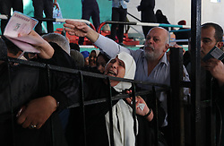April 28, 2018 - Khan Yunis, Gaza Strip, Palestinian Territory - Palestinians wait for travel permits to cross into Egypt through the Rafah border crossing after it was opened by Egyptian authorities for humanitarian cases, in Khan Yunis in the southern Gaza Strip on April 28, 2018  (Credit Image: © Ashraf Amra/APA Images via ZUMA Wire)