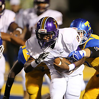Columbus running back Michello Garrick II, fights his way through the Tupelo defense on Friday night.