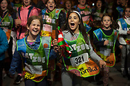 "Two young girls carry the baton as they run on the 20th Korrika. Kadreita. (Basque Country). March 31, 2017. The ""Korrika"" is a relay course, with a wooden baton that passes from hand to hand without interruption, organised every two years in a bid to promote the basque language. The Korrika runs over 11 days and 10 nights, crossing many Basque villages and cities. This year was the 20th edition and run more than 2500 Kilometres. Some people consider it an honour to carry the baton with the symbol of the Basques, ""buying"" kilometres to support Basque language teaching. (Gari Garaialde / Bostok Photo)"