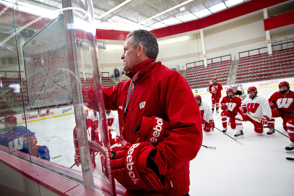 UW-Madison Women's Hockey coach Mark Johnson writes out a play on the whiteboard during practice in the LaBahn Arena, Tuesday, January 6, 2015.