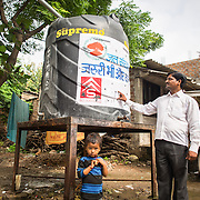 CAPTION: Dinesh Malviya believes that community storage tanks have resulted in water security and eliminated the daily struggle and squabbles seen earlier. LOCATION: Devshree Nagar, Indore, Madhya Pradesh, India. INDIVIDUAL(S) PHOTOGRAPHED: Dinesh Malviya.