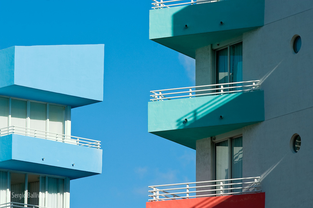 The colorful paint and architecture details of many ArtDeco buildings are seen in South Beach, Miami, Florida.