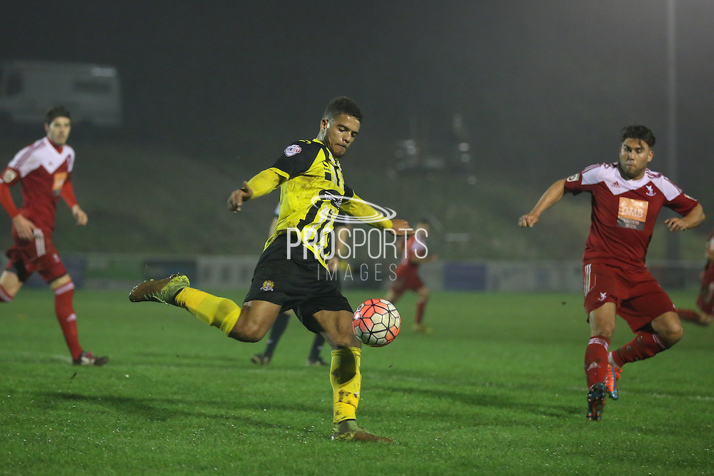 Dagenham player Joss Labadie clears  during the The FA Cup 2nd Round Replay match between Whitehawk FC and Dagenham and Redbridge at the Enclosed Ground, Whitehawk, United Kingdom on 16 December 2015. Photo by Phil Duncan.